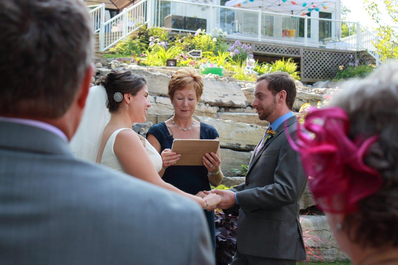 A couple looking at each other as the officiant conducts their wedding ceremony