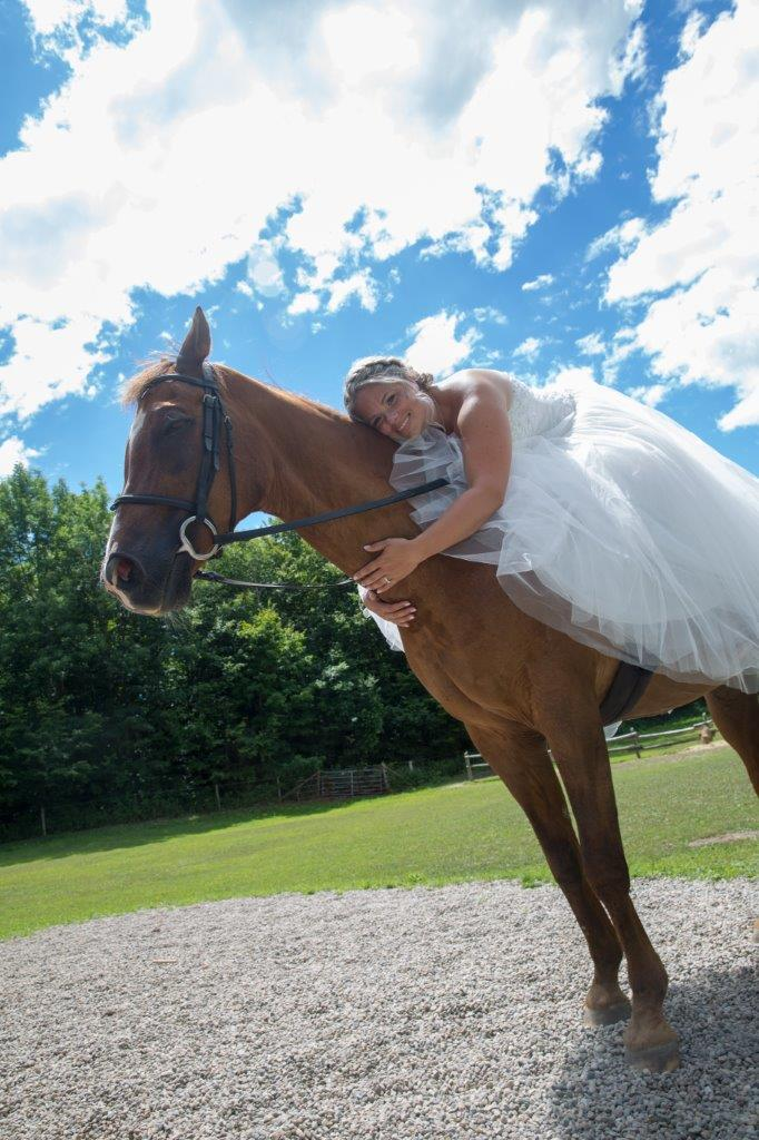 Bride sitting on a horse