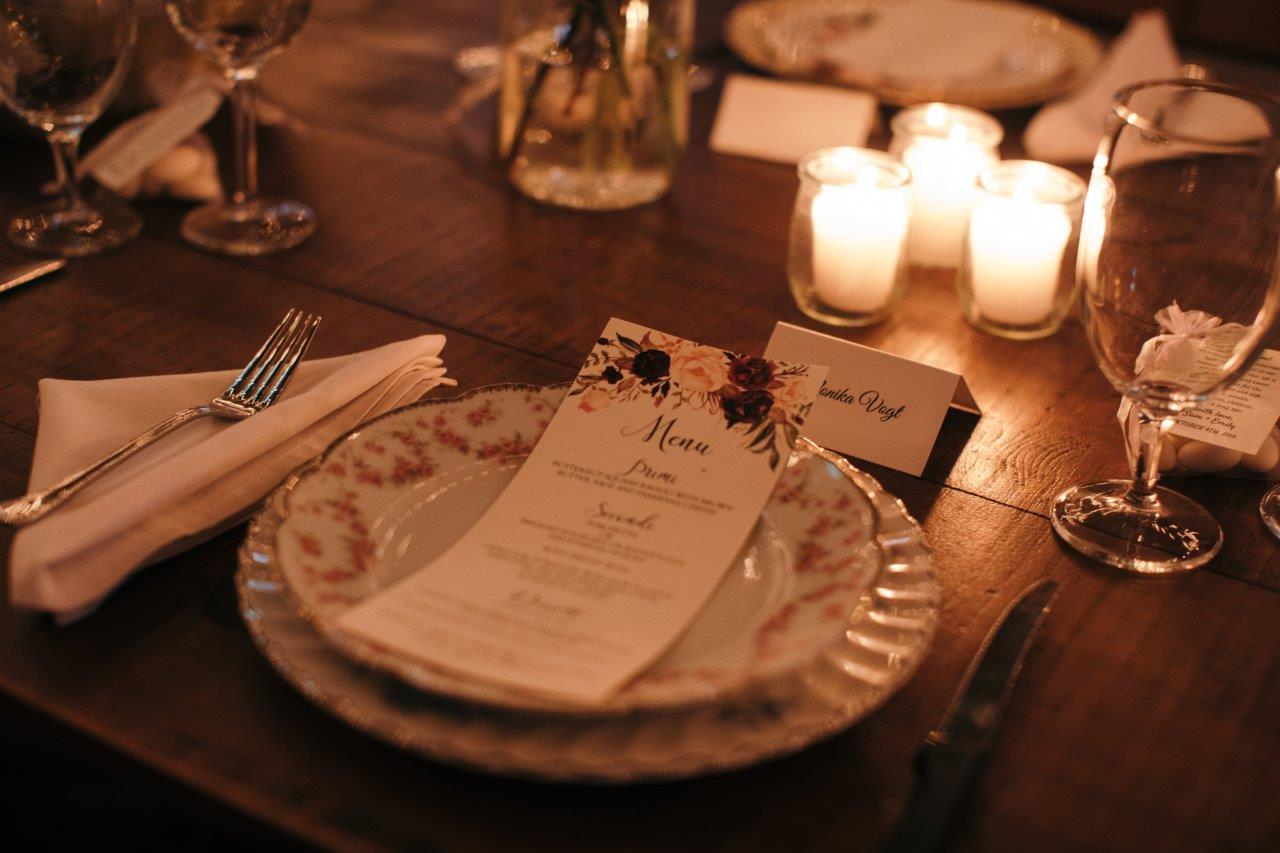 Table setting with name tag and menu and vintage china