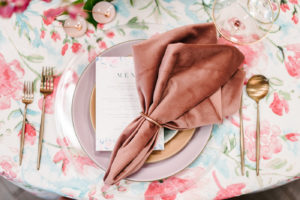 Velvet napkin on floral tablecloth